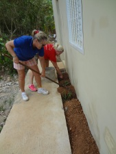 Dom Repub - Cathy & Angela cleaning and landscaping at clinic and school