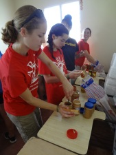 Dom Repub - Mariah & Maggie making lunch for fire victims